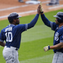 San Diego Padres' Justin Upton, left, is congratulated by teammate Matt Kemp after scoring on a single by Derek Norris during the second inning of a baseball game against the Los Angeles Dodgers, Sunday, May 24, 2015, in Los Angeles. (AP Photo/Mark J. Terrill)