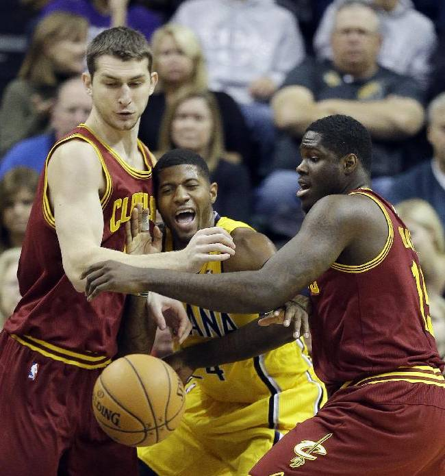 Indiana Pacers' Paul George, middle, battles for a loose ball against Cleveland Cavaliers' Tyler Zeller, left, and Anthony Bennett during the first half of an NBA basketball game Saturday, Nov. 2, 2013, in Indianapolis