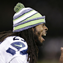 Seattle Seahawks cornerback Richard Sherman yells on the sideline during the second half of an NFL preseason football game against the Oakland Raiders in Oakland, Calif., Thursday, Aug. 28, 2014 The Associated Press