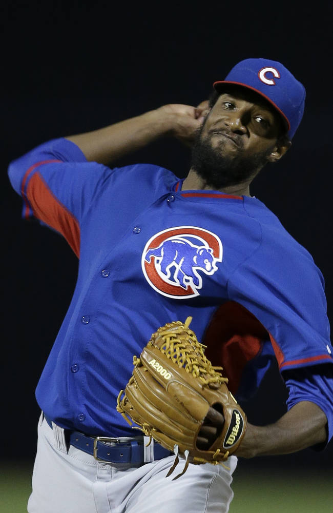 Chicago Cubs starting pitcher James McDonald throws before a spring exhibition baseball game against the Seattle Mariners ,Wednesday, March 12, 2014, in Peoria, Ariz