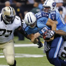 Tennessee Titans quarterback Jake Locker (10) is tackled by New Orleans Saints defensive end Cameron Jordan (94) and nose tackle Brodrick Bunkley (77) in the first half of a NFL preseason football game in New Orleans, Friday, Aug. 15, 2014 The Associated
