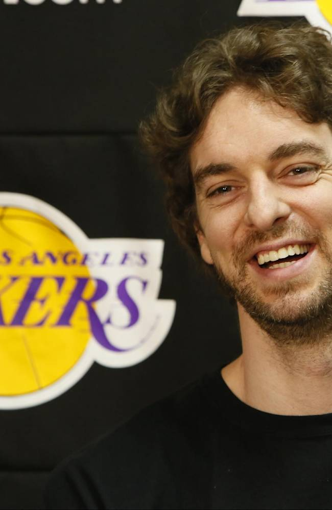In this April 30, 2013 file photo, Los Angeles Lakers power forward Pau Gasol smiles while talking to reporters during an NBA basketball news conference in El Segundo, Calif.  Gasol spent the past few seasons changing his game to accommodate Andrew Bynum and Dwight Howard. Now that both centers have left Los Angeles, the Spanish 7-footer is eager to resume his role as the Lakers' man in the middle