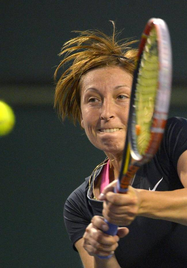 Yvonne Meusburger, of Austria, returns a shot to Jelena Jankovic, of Serbia, at the BNP Paribas Open tennis tournament, Friday, March 7, 2014, in Indian Wells, Calif