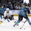 San Jose Sharks right wing Brent Burns (88) takes a shot in front of Nashville Predators center Matt Cullen (7) during the first period of an NHL hockey game Saturday, April 5, 2014, in San Jose, Calif The Associated Press