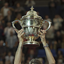 Switzerland's Roger Federer cheers with the trophy after winning the final match against Belgium's David Goffin at the Swiss Indoors tennis tournament in Basel, Switzerland, on Sunday, Oct. 26, 2014. (AP Photo/Keystone,Georgios Kefalas)