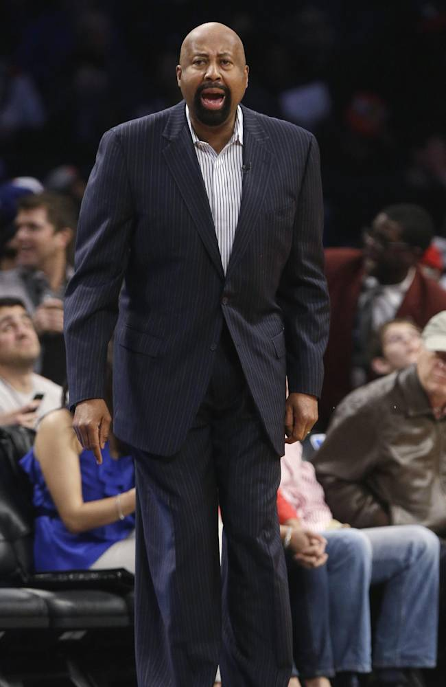 New York Knicks coach Mike Woodson calls out to his team during the first half of an NBA basketball game against the Brooklyn Nets on Tuesday, April 15, 2014, in New York