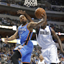 Oklahoma City Thunder guard Derek Fisher (6) drives to the basket against Dallas Mavericks center Samuel Dalembert (1) during the first half of an NBA basketball game Tuesday, March 25, 2014, in Dallas The Associated Press