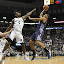 Charlotte Bobcats guard Gary Neal (12) shoots against Memphis defenders Kosta Koufos (41), Tony Allen (9) and Jon Leuer (30) in the first half of an NBA basketball game Saturday, March 8, 2014, in Memphis, Tenn The Associated Press