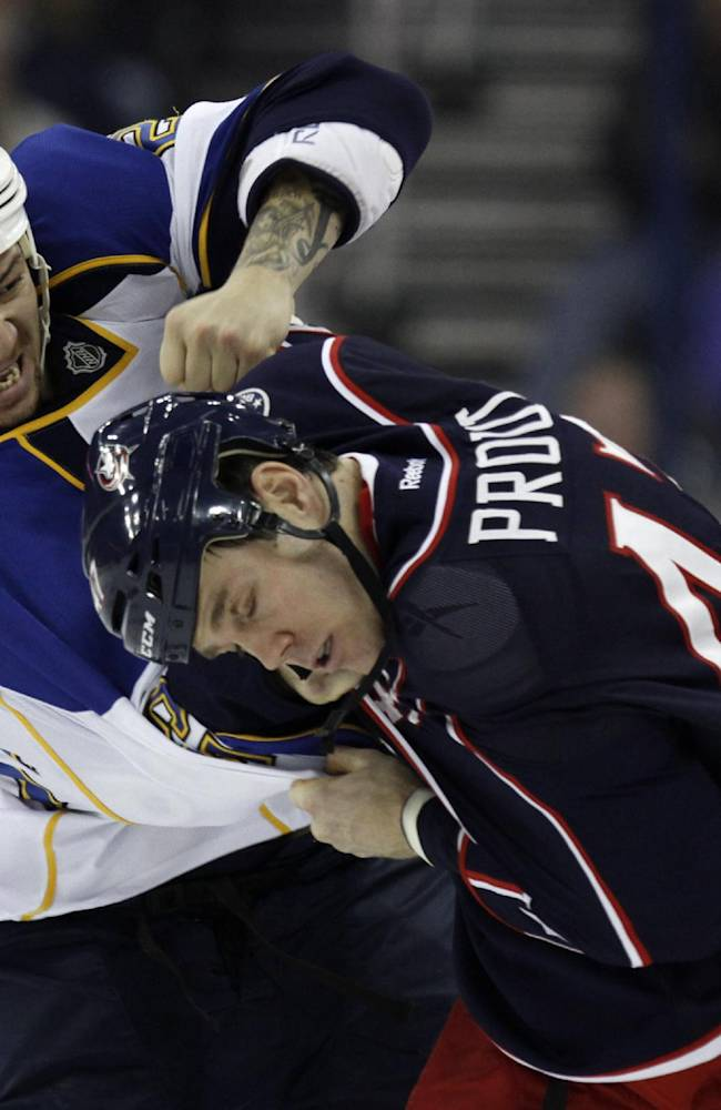 St. Louis Blues' Chris Stewart, left, fights with Columbus Blue Jackets' Dalton Prout in the first period of an NHL hockey game in Columbus, Ohio, Saturday, Dec. 14, 2013
