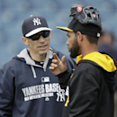 New York Yankees manager Joe Girardi, left, talks with Pittsburgh Pirates shortstop Robert Andino before an exhibition baseball game Thursday, Feb. 27, 2014, in Tampa, Fla The Associated Press