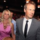 Detroit Red Wings captain Nicklas Lidstrom of Sweden and his wife Annika arrive for the news conference where he announced his retirement in Detroit, Thursday, May 31, 2012. Lidstrom retires after a 20-season career.  (AP Photo/Carlos Osorio)