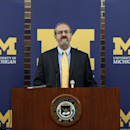 University of Michigan President Mark Schlissel announces that athletic director Dave Brandon resigned during a news conference in Ann Arbor, Mich., Friday, Oct. 31, 2014. Former Steelcase CEO Jim Hackett will serve as Michigan's interim athletic director. (Photo/Paul Sancya)