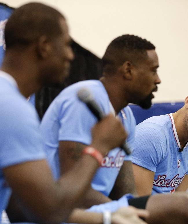 Los Angeles Clippers' Blake Griffin, right, with DeAndre Jordan, center, watches teammate Chris Paul answer a question during the team's NBA basketball media day on Monday, Sept. 30, 2013, in Los Angeles