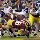 Washington Redskins running back Alfred Morris (46) dives for a touchdown during the first half an NFL football game against the New York Giants, Sunday, Dec. 1, 2013, in Landover, Md The Associated Press