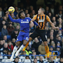 Chelsea's Willian, left, vies for the ball with Hull's Jake Livermore during their English Premier League soccer match between Chelsea and Hull City at Stamford Bridge stadium in London, Saturday, Dec 13, 2014