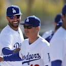 Los Angeles Dodgers' Matt Kemp, left, smiles with teammates during spring training baseball practice in Glendale, Ariz., Friday, Feb. 14, 2014 The Associated Press