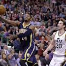 Indiana Pacers' Paul George (24) shoots as Utah Jazz's Gordon Hayward (20) looks on in the second quarter during an NBA basketball game Wednesday, Dec. 4, 2013, in Salt Lake City. (AP Photo/Rick Bowmer)