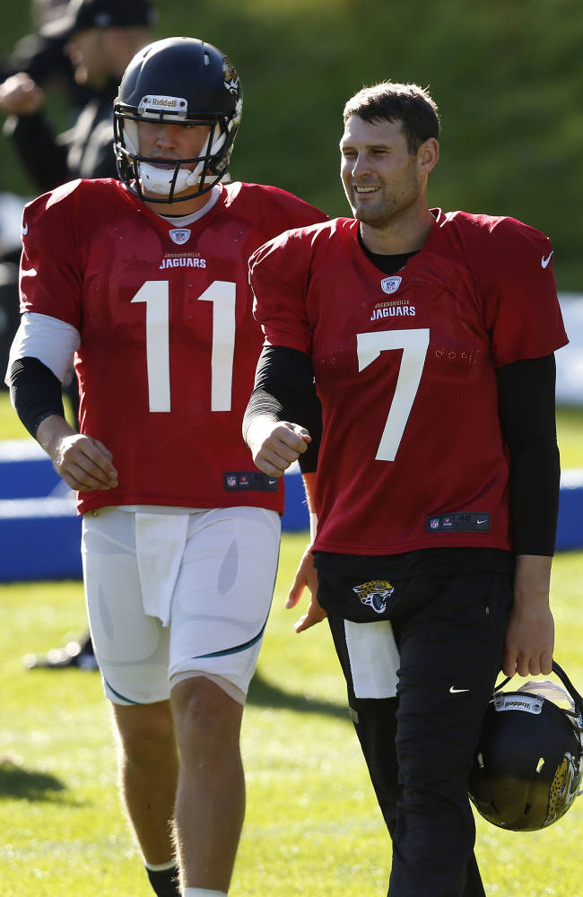 Jacksonville Jaguars' quarterback Chad Henne, right, and quarterback Blaine Gabbert take part in their football practice at the Pennyhill Park Hotel and Spa in Bagshot, England, Wednesday, Oct. 23, 2013. The Jaguars face the San Francisco 49ers on Sunday in a NFL football game at Wembley Stadium in London
