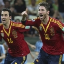 Spain's Sergio Busquets, left, and Sergio Ramos celebrate after defeating Italy 7-6 during a penalty shoot-out in the soccer Confederations Cup semifinal match at the Castelao stadium in Fortaleza, Brazil, Thursday, June 27, 2013. (AP Photo/Eugene Hoshiko)