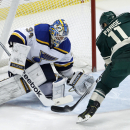 St. Louis Blues goalie Jake Allen (34) deflects a shot by Minnesota Wild left wing Zach Parise (11) during the first period of an NHL hockey game in St. Paul, Minn., Saturday, Nov. 29, 2014 The Associated Press