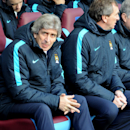 Manchester City manager Manuel Pellegrini in the dug out during the English FA Cup fourth round soccer match between Aston Villa and Manchester City at Villa Park in Birmingham, England, Saturday, Jan. 30, 2016. (AP Photo/Rui Vieira)