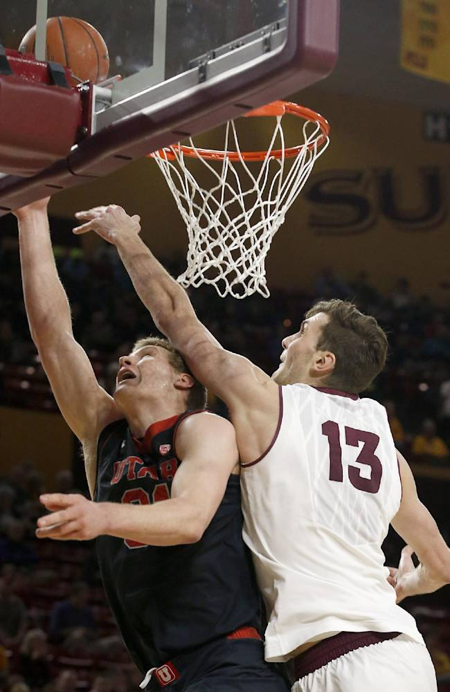 Arizona State's Jordan Bachynski (13) blocks the shot of his brother Utah's Dallin Bachynski during the first half of an NCAA basketball game Thursday, Jan. 23, 2014, in Tempe, Ariz