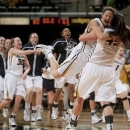 Missouri's Liz Smith, right, is hugged by teammate Liene Priede as the rest of the team rushes the court after they upset Tennessee in an NCAA college women's basketball game on Sunday, Feb. 3, 2013, in Columbia, Mo. Missouri won the game 80-63. (AP Photo/L.G. Patterson)