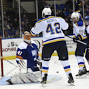 St. Louis Blues center David Backes (42) and center Paul Stastny (26) celebrate after teammate T.J. Oshie scored a goal as New York Islanders goalie Jaroslav Halak (41) and defenseman Thomas Hickey (14) react in the third period of an NHL hockey game at