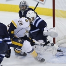 Winnipeg Jets goaltender Ondrej Pavelec (31) gets a pad on the shot from Nashville Predators' Paul Gaustad (28) as Jets' Adam Pardy (2) follows up during the first period of an NHL hockey game Friday, Oct. 17, 2014, in Winnipeg, Manitoba The Associated Pr