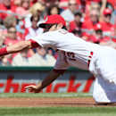 St. Louis Cardinals third baseman Matt Carpenter fields a ball off the bat of Cincinnati Reds' Mike Leake in third inning action during a game between the St. Louis Cardinals and the Cincinnati Reds on Wednesday, April 9, 2014, at Busch Stadium in St. Lou