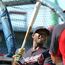 Atlanta Braves' Justin Upton talks with a teammate during batting practice before a baseball game against the Washington Nationals, Saturday, April 12, 2014, in Atlanta The Associated Press