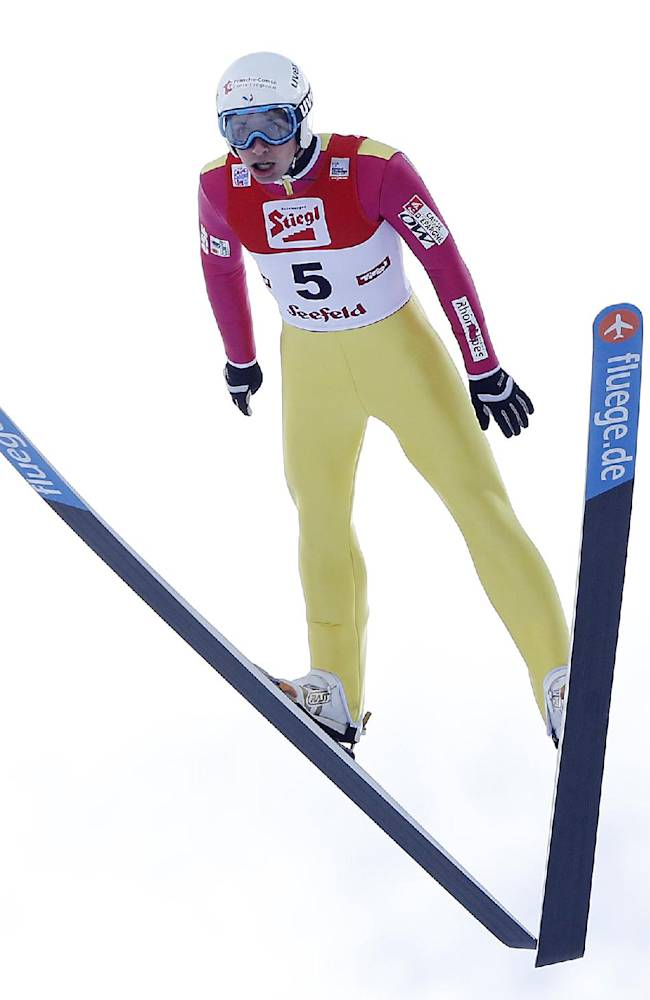 France's Jason Lamy Chappuis soars through the air during the ski jumping portion on the final day of the Nordic Combined triple World Cup in Seefeld, Austria, Sunday, Jan.19, 2014