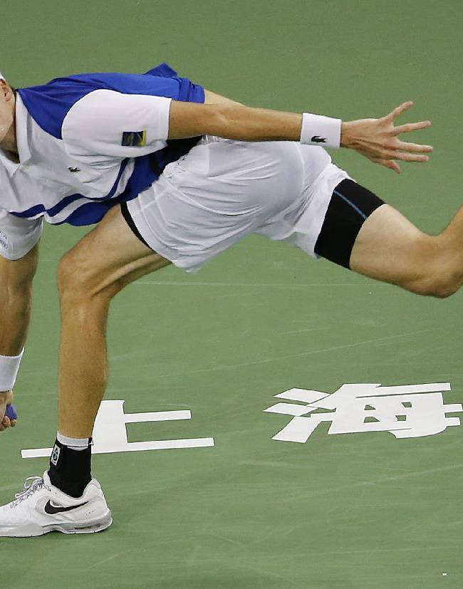 John Isner of the United States looks at the ball as he returned against Santiago Giraldo of Colombia at the first round of the Shanghai Masters tennis tournament at Qizhong Forest Sports City Tennis Center, in Shanghai, China, Monday, Oct. 7, 2013. Isner won 4-6, 7-5 7-5