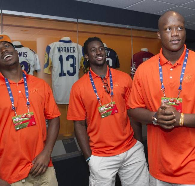 Miami Dolphins rookies Matt Hazel, Walt Aikens, center and Ja'Wuan James, react while watching a video, during the 2014 NFL Rookie Symposium at the Pro Football Hall of Fame in Canton, Ohio, Saturday, June 28, 2014