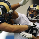 Rams tackle D.J. Morrell, left, and offensive lineman Greg Robinson practice during first day of NFL football training camp for rookies on Tuesday, July 22, 2014, at Rams Park in Earth City, Mo The Associated Press