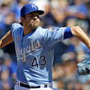 In this July 27, 2014, file photo, Kansas City Royals relief pitcher Aaron Crow throws to a batter in the ninth inning of a baseball game against the Cleveland Indians at Kauffman Stadium in Kansas City, Mo. The former first-round draft pick was traded Fr