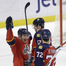 Florida Panthers defenseman Dmitry Kulikov (7) celebrates after scoring against the Columbus Blue Jackets in the third period of an NHL hockey game in Sunrise, Fla., Thursday, Jan. 29, 2015. The Panthers won 3-2 The Associated Press