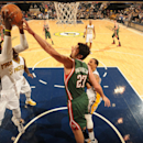 Roy Hibbert #55 of the Indiana Pacers grabs a rebound during a game against the Milwaukee Bucks at Bankers Life Fieldhouse on February 25, 2014 in Indianapolis, Indiana. (Photo by Ron Hoskins/NBAE via Getty Images)