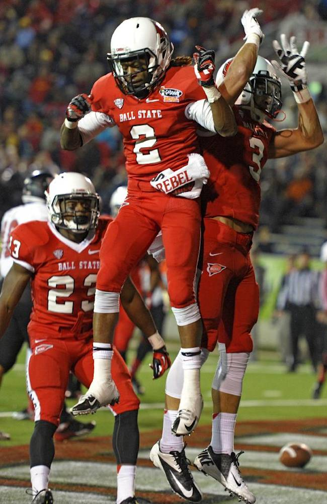 Ball State wide receiver Jamill Smith (2) does a celebratory leap with wide receiver Willie Snead (3) following Sneads' touchdown reception against Arkansas State in the first quarter of the GoDaddy Bowl NCAA college football game., Sunday, Jan. 5, 2014, in Mobile, Ala