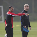 Manchester United's manager David Moyes, right, stands alongside Ryan Giggs as the team trains at Carrington training ground in Manchester, Monday, March 31, 2014. Manchester United will play Bayern Munich in a Champions League quarter final first leg soc