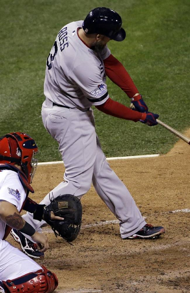 Boston Red Sox's David Ross hits an RBI double during the seventh inning of Game 5 of baseball's World Series against the St. Louis Cardinals Monday, Oct. 28, 2013, in St. Louis