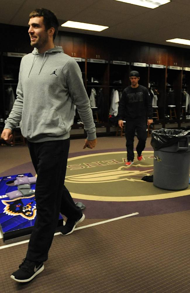 Baltimore Ravens quarterback Joe Flacco walks into the locker room as the team cleans out their lockers Monday, Dec. 30, 2013 in Owings Mills, Md