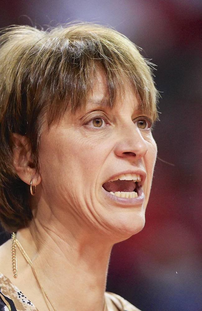 **FILE** In this file photo from Nov. 27, 2013, Nebraska coach Connie Yori calls instructions in the first half of an NCAA college basketball game against UMass Lowell in Lincoln, Neb. On Tuesday, Feb. 18, 2014, two days after collapsing during a game, Yori said her health was fine and she will be with the team at Ohio State on Thursday. Yori said she has been fighting a bacterial infection for a couple weeks and was dehydrated when she passed out in front of the Cornhuskers' bench in the second half of Sunday's game against Indiana