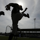 New York Yankees right fielder Ichiro Suzuki, center, warms up on the field before an exhibition baseball game against the Tampa Bay Rays, Wednesday, March 5, 2014, in Port Charlotte, Fla The Associated Press