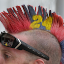 A fan has his hair painted to honor driver Jeff Gordon during the NASCAR Brickyard 400 auto race at Indianapolis Motor Speedway in Indianapolis, Sunday, July 26, 2015. (AP Photo/Darron Cummings)