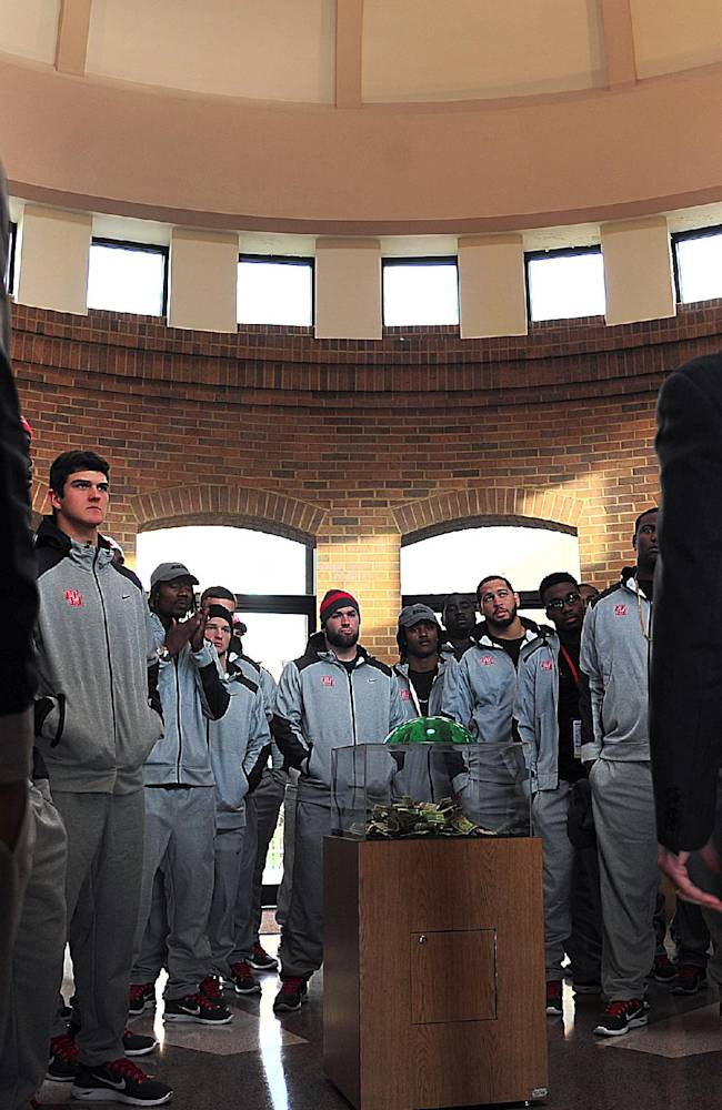 Bill Todd greets Houston players before they toured the Birmingham Civil Rights Institute in Birmingham, Ala., Thursday, Jan. 2, 2014. Houston and Vanderbilt will play in the BBVA Compass Bowl NCAA college football game Saturday