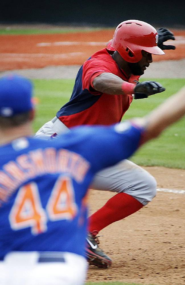 Washington Nationals' Denard Span, right, dives back to first base as New York Mets pitcher Kyle Farnsworth throws in a pickoff attempt in the ninth inning of an exhibition spring training baseball game, Thursday, March 27, 2014, in Port St. Lucie, Fla