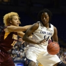 Penn State's Nikki Greene (54) works around Minnesota's Micaella Riche (15) during the first half of an NCAA college basketball game in State College, Pa., Thursday, Jan. 24, 2013. (AP Photo/Ralph Wilson)