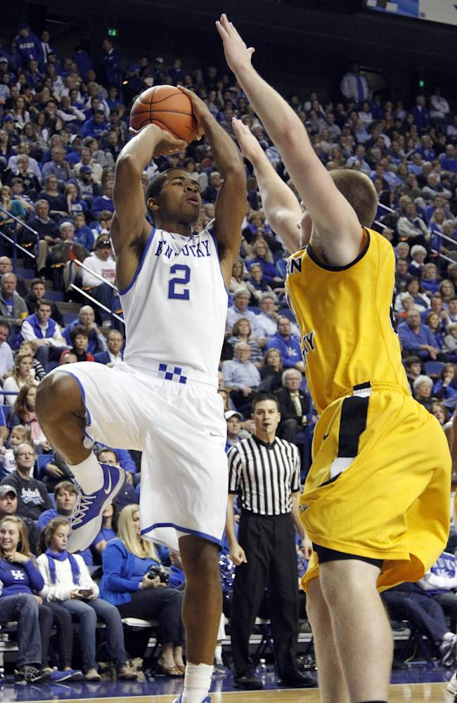 Kentucky's Aaron Harrison (2) shoots under pressure from Northern Kentucky's Matt Rosenwinkel during the second half of an NCAA college basketball game, Sunday, Nov. 10, 2013, in Lexington, Ky