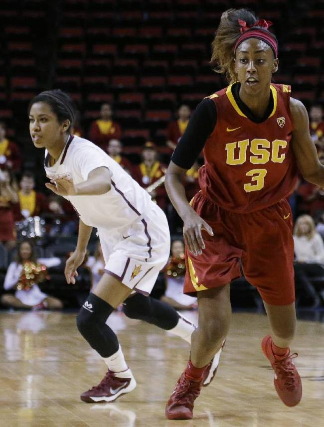 Southern California's Desiree Bradley (3) dribbles around Arizona State's Arnecia Hawkins during the first half of an NCAA college basketball game in the second round of the Pac-12 women's tournament, Friday, March 7, 2014, in Seattle